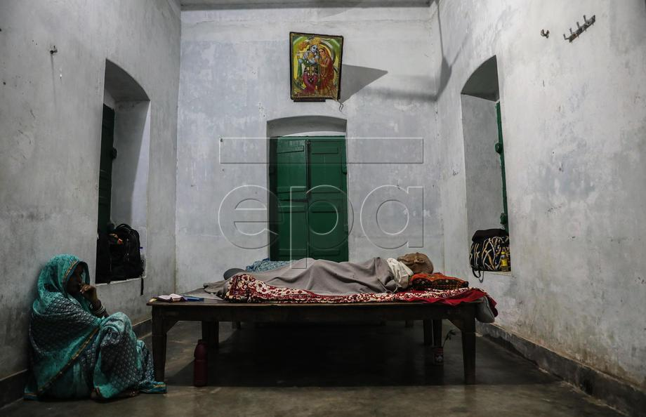 A relative sits next to the dead body of Kodu Singh Parmar, that died inside his room at Kashi Labh Mukti Bhawan in Varanasi, India, 09 October 2019. Kashi Labh Mukti Bhawan is a charity-run a place that offers lodging to those who wish to give up their last breath in the holy city of Varanasi (also known as Banaras or Kashi) to achieve Moksha, a Hindu term for enlightenment or release. There is a saying in Sanskrit, Kashyam Marnata Mukti, which means that one will get Moksha if he dies in Kashi. The city is situated on the banks of river Ganges, one of the holiest sites in Hinduism and Uttar Pradesh for Hindu pilgrims from around the world. Many Hindus approaching the ends of their lives come to the sacred city in the belief that they might achieve Moksha by dying and having their ashes scattered in the Ganges River in Varanasi. To attain this salvation, thousands of people travel to Varanasi to die. The so-called 'death hotel' has 10 rooms for guests, a temple where they have special prayers three times a day, an office room and small quarters for its priests. Guests who are not medically fit and within days of dying are allowed to take shelter in the house for two weeks with minimal charges. There is a condition to die within two weeks; if the health of the guest improves they are asked to move on. The house offers the service for free to those who cannot afford it. The price of the stay is 20 INR or 0.25 euro per day, a fare which covers electricity and some basic costs. EPA-EFE/DIVYAKANT SOLANKI