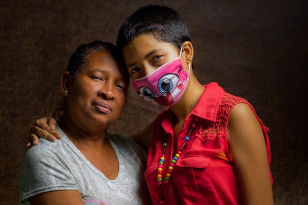 Rosa Colina poses with her 17-year-old daughter Cristina in Caracas, Venezuela, 23 May 2019. Cristina has been diagnosed with major thalassemia, systemic lupus erythematosus and Hepatitis C. Her treatment consists of Exjade and transfusions, which must be done every 21 days. 'It is not easy to stand the criticism of people on the street. For example, on December 24 past year we were walking and a group of young people approached. I heard one say to the other: 'Look, she has AIDS'. 'That was devastating for