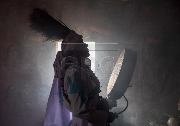 A shaman plays the drum while performing rituals in Kathmandu, Nepal, 28 March 2019. Shamans, or 'Jhakri', as they are known in Nepal, are healers who provide spiritual and physical healing and cleansing. Using a combination of Hindu worship, mantras, meditation and traditional herbal remedies, the shamans are believed to help people who have been unable to find a cure through modern medicine or who have become possessed by spirits. EPA-EFE/NARENDRA SHRESTHA
