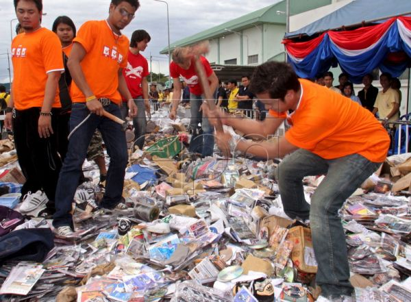 Thai singers and artists destroy counterfeit CD movies and cassettes at Bang Pu industrial area in the outskirts of Bangkok, Thailand on F​riday 30 June 2006. Thai authorities destroyed confiscated 1.6 million pieces of counterfeit goods like video CDs, karaoke, MP3, computer programs, wa​tches, signature RTW, and others items, worth 132 millions bahts (2.75 million euros). EPA/NARONG SANGNAK