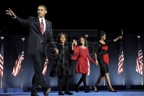 Democratic presidential candidate Barack Obama walks onstage with his family (L-R) Natasha, Malia and his wife Michelle as they arrives to address a crowd at Grant Park in Chicago, Illinois, USA, to celebrate his victory on Election Day 04 November 2008. The first anniversary of Obama's inauguration as the 44th President of the United States is 20 January 2010. Obama's election as the first black President of the United States generated massive attention. He was celebrated by a world which expected him to i