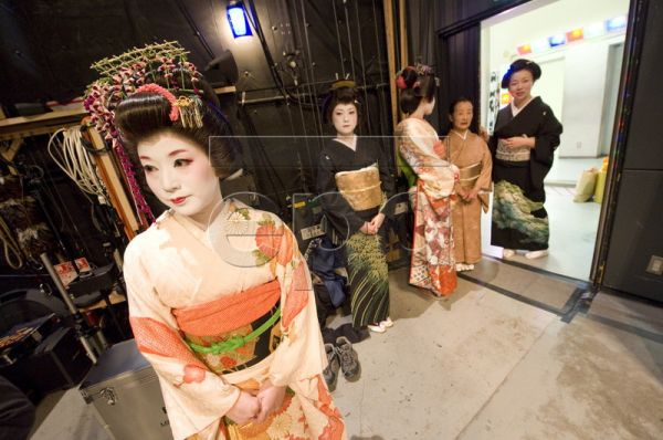 Japanese geisha wait back stage prior to a dance performance at a public theater in downtown Tokyo, Japan, 03 May 2010. Geisha, which translated into English means 'entertainer,' have the image internationally as a kind of high class courtesan, where as in fact the typical geisha is a performer of traditional dance and music, who entertains in groups for special events and banquets and at public theaters. During Japan's Golden Week Holidays, lasting from 01 to 05 May, many cultural performances are being he