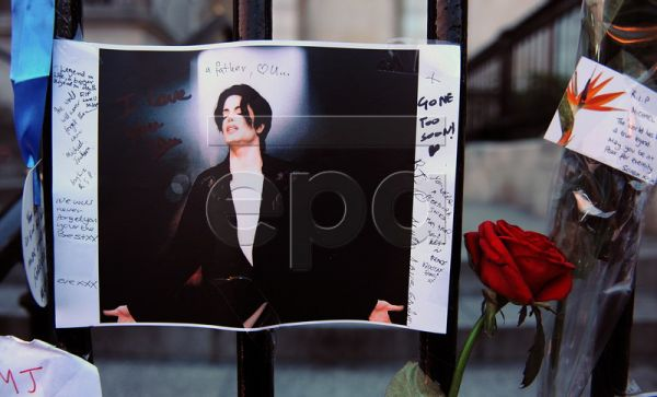 A file picture dated 26 June 2009 shows Michael Jackson fans leave flowers and pictures of the late US singer at a vigil in London, Britain. The first anniversary of Michael Jackson's death is on 25 June 2010. As one of the most popular recording artists of all time, his sudden death triggered a worldwide outpouring of grief. Jackson was in the middle of rehearsals for a run of 50 concerts in London that were in the singer's own words to be his 'final curtain call' and a grand finale to a glorious career. M