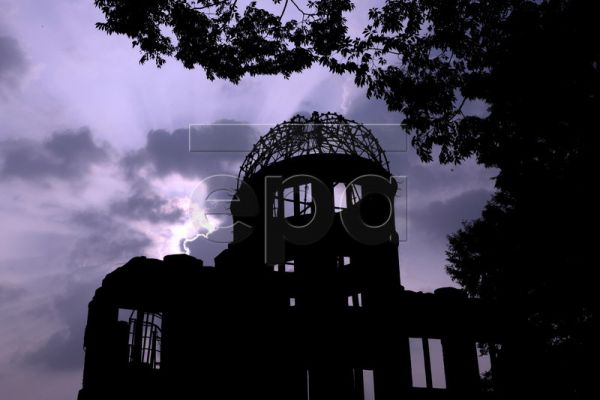 A file photo dated 05 August 2008 shows the A-bomb dome silhouetted at dusk at the Peace Memorial Park in Hiroshima, western Japan. United Nations Secretary General Ban Ki-moon arrived in Japan 03 August 2010 to visit Hiroshima and Nagasaki, the two cities where the US military dropped atomic bombs 65 years ago. Ban will be the first UN secretary general to attend the Peace Memorial Ceremony in Hiroshima. For the first time the United States will send an envoy to the memorial. The US bomber Enola Gay droppe