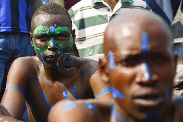 A Nubian wrestler from Nairobi's Kibera slum looks on as he sits with his teammates during the African traditional wrestling tournament held in Kibera slum in Nairobi, Kenya, 14 August 2010. Several teams of Nubians residing in Kibera slum participated in the one-day event. The tournament was organized by Sports for Youth Development Initiative (SYDI), a local NGO aiming to use sports to address and tackle the social and economic problems encountered by Nairobi's marginalized youth. The team of Nubian wrest