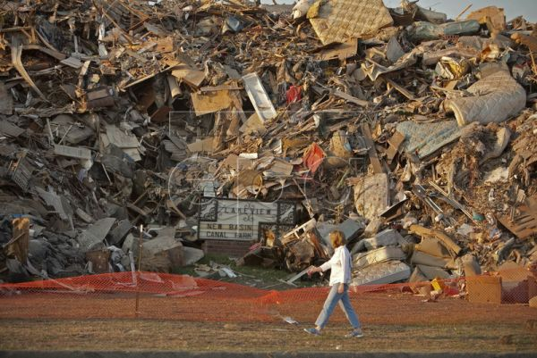 A picture dated 21 October 2005 shows a woman walking past a mountain of debris that took up entire city blocks from homes destroyed by the breach in the 17th Street Canal containment wall during Hurricane Katrina in the Lakeview section of New Orleans, Louisiana, USA. Hurricane Katrina hit the U.S. Gulf Coast on 29 August 2005 after forming from the remains of a tropical wave and Tropical Depression 10 almost 950 miles east of Barbados. By 31 August it was estimated that 80 percent of New Orleans was under