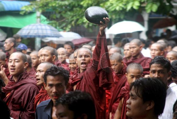A file picture dated 24 September 2007 shows a buddhist monk holding the traditional monk bowl upside down in defiance and protest during a march against the military junta of Buddhist monks and laymen in Yangon Myanmar. According to the country's Election Commission, more than 29 million eligible voters will cast their ballots in 1,103 constituencies contested by 3,071 candidates for the upper, lower and regional houses of Parliament on 07 November 2010 in Burma, officially the Republic of the Union of Mya