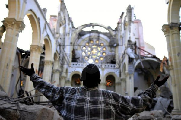 A file picture dated 31 January 2010 shows a man praying at the Cathedral of Port-au-Prince, Haiti. A year after the Caribbean nation was struck by a magnitude 7.0 earthquake that killed approximately 230,000 people and left around 1.5 million survivors displaced or homeless, it is still unclear how far away Haiti is from total recovery. EPA/ULISES RODRIGUEZ
