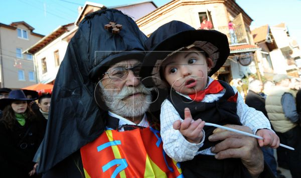 The oldest participant Boris, aged 94, holds the youngest participant Martin, aged 15 months, on the second day of a carnival marking the Orthodox St. Vasilij Day in the village of Vevcani, some 170 km from the capital of Skopje, The Former Yugoslav Republic of Macedonia, 14 January 2011. The Vevcani Carnival is one of the most famous village festivals held in the Balkans. It is believed that the custom is over 1,400 years old. It is based on old pagan beliefs and rituals. Essentially the carnival is the ri