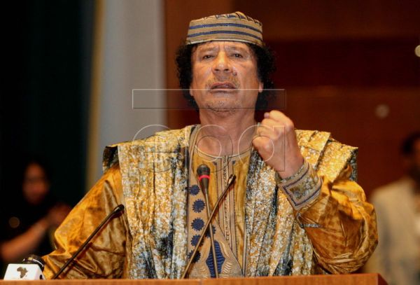 A file photo dated 09 September 2006 shows Libyan leader Muammar Gaddafi as he delivers a speech during the celebrations marking the seventh anniversary of the creation of the African Union (AU) in Sirte, Libya. Born in 1942 in Sirte, then Italian Libya, into a Bedouin family, Gaddafi went to a military academy and joined an anti-monarchy conspiracy, which brought him into power by coup d'etat against King Idris on 01 September 1969. His 41-year rule as 'Leader of the Revolution' may now come to a violent e