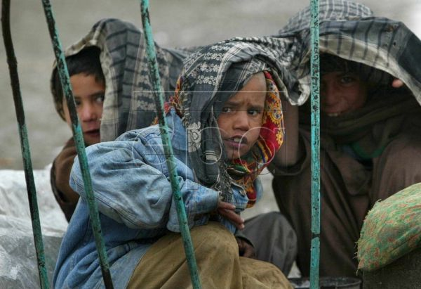 A file picture dated 13 January 2002 shows Afghan refugee children peer through a fence in a makeshift refugee camp in the outskirts of Kabul, Afghanistan. The tenth anniversary of the invasion of Afghanistan is marked on 07 October 2011. On 07 October 2001 the United States of America launched Operation Enduring Freedom in Afghanistan in response to the terrorist attacks on the United States of 09 September 2001. The stated goal was to dismantle the Al Qaeda terrorist organization and end its use of Afghan