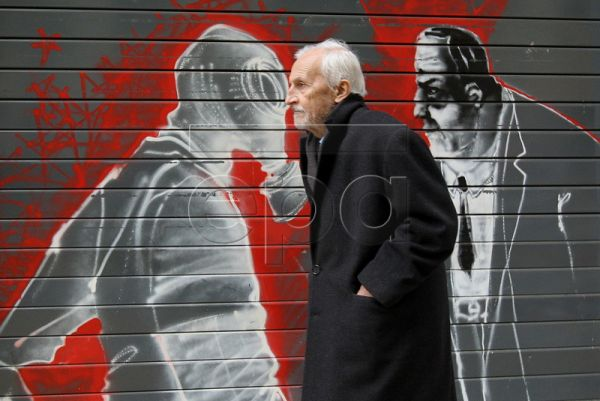 A man walks by a graffiti-filled wall in the center of Athens, Greece, 14 November 2011. Graffiti is a reflection of contemporary situatio​ns and public sentiment, and the deep crisis and recession in Greece, coupled with heavy austerity, is an inspiration for street artists in the Greek ​capital. EPA/ORESTIS PANAGIOTOU
