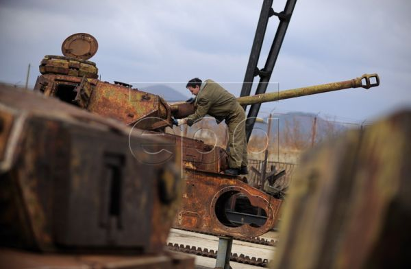 A military mechanic in the process of repairing a German Panzer T4 at the repair facilities of the Bulgarian Army in Sliven, some 300km from Sofia, Bulgaria, 25 November 2011. A total of 15 German tanks of the types Panzer T3 and T4 are being restored in the repair facilities of the Bulgarian Army. All the tanks were manufactured by 1943. One of the most valuable exhibits is a Jagdpanzer T4 L 48, which is unique in Bulgaria and is one of seven in the world. Once the restoration work is complete the tanks ar
