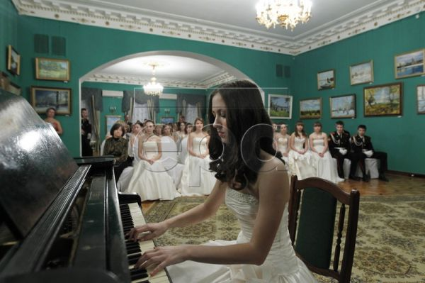 A girl plays piano during a Cadet Ball at the Russian Defense Ministry's Culture Center in Moscow, Russia, 20 November 2011. The girls of the Russian Defense Ministry's boarding school for girls take part in this traditional cadet ball. The school which opened on 01 September 2008 provides secondary education for the daughters of Russian servicemen/women. Besides the core curricula, many additional subjects are taught: three foreign languages, dance, sport, art and music. Today the number of pupils amounts
