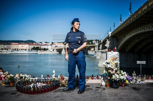 Lieutenant Colonel Bettina Kutsera-Juhasz, Division Head of the Public Order Department of the Budapest Police Headquarters is portrayed at the victims' memorial near the scene of the accident, at the Pest embankment of Margaret Bridge in Budapest, Hungary, 17 July 2019. 'Like all well-meaning people, I was shaken when I learned about the accident, and as a professional, the urge to help came over me right away', she recalls. Her colleagues closed off the northern side of the Margaret Bridge and the Pest em