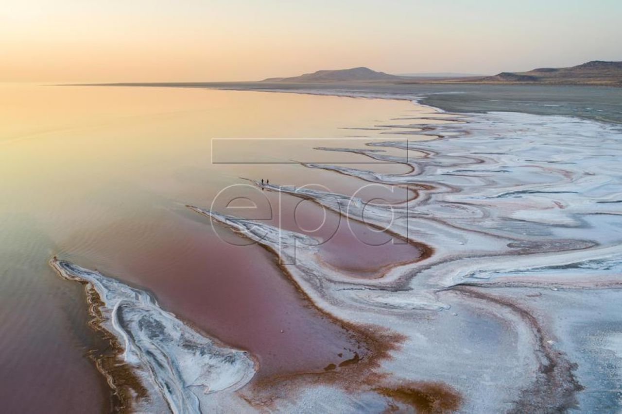 An image made with a drone shows visitors on the salt flats watching the sunset over the Great Salt Lake, Utah, 04 October 2020. Utah's Great Salt Lake has lost 50 percent of its volume since the arrival of Mormon pioneers in 1847. Two decades of drought are not the only reason for the lake's shrinking shoreline—above average temperatures, and water diversion for agriculture and drinking water, are also to blame. EPA-EFE/JIM LO SCALZO